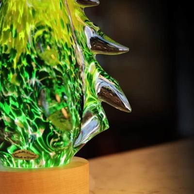 sculpture sapin en cristal sur socle lumineux